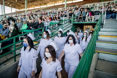 Nursing students walking in at pinning ceremony