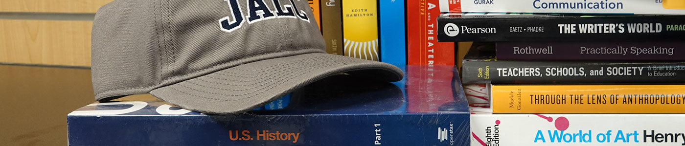 Communication, Humanities, and Social Science books and JALC hat